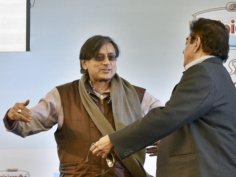 Congress leader Shashi Tharoor (L) and BJP leader Sharughan Sinha during the session