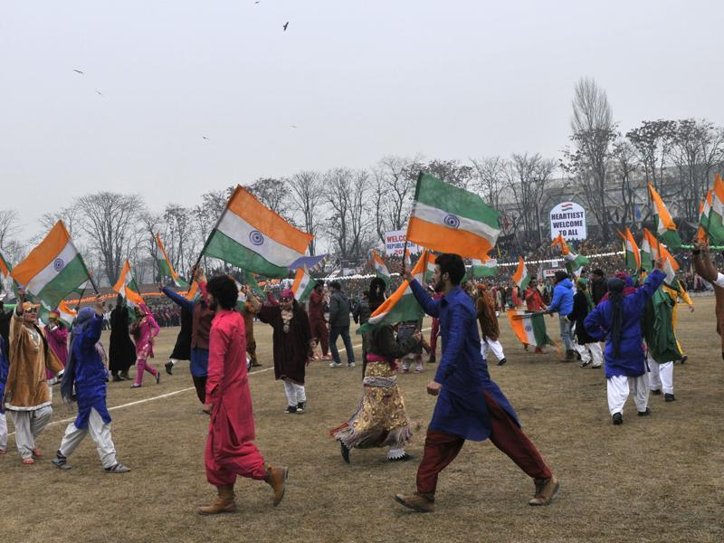 Kashmiri dancers hold national flags as they dance during India's 67th Republic Day celebrations in Srinagar, India 26 January 2016. India celebrated its 67th Republic Day Monday amid tight security in Kashmir.(Photo by Waseem Andrabi/ Hindustan Times) (Waseem Andrabi/HT Photo)