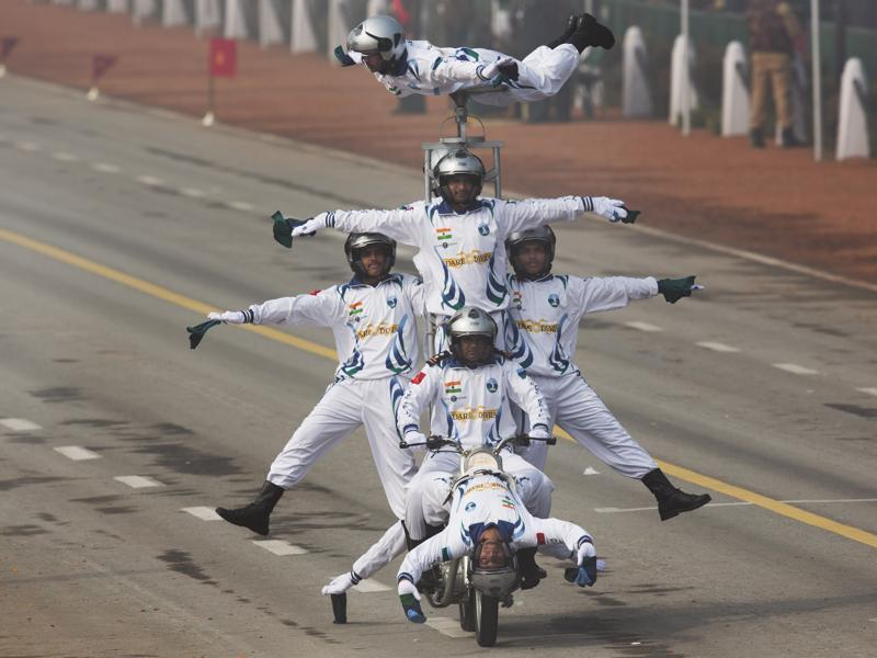 Motorcycle display team of Indian Army's 'Corps of Signals', popularly known as 'Dare Devils', make a formation on a motorcycle as they roll down Rajpath during the Republic Day parade in New Delhi. (AP Photo)