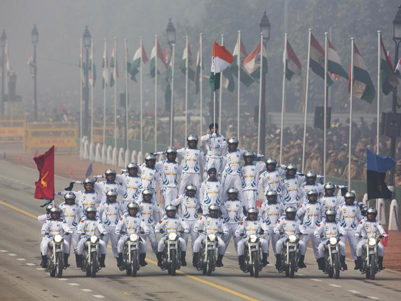 Soldiers make formations on motorcycles as they roll down Rajpath during the Republic Day parade in New Delhi. (AP Photo)