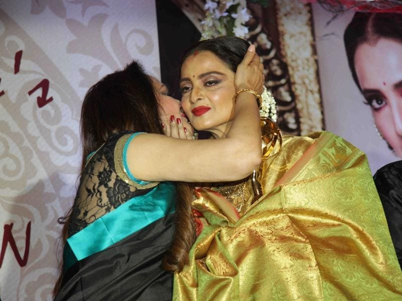Veteran actors Rekha and Jayaprada hug each other at the 3rd National Yash Chopra Memorial Awards. (IANS)