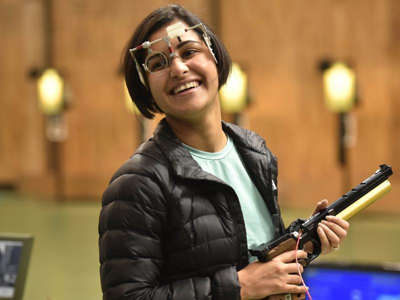 Shooter Heena Sidhu is all smiles after winning gold in the 10 metre air pistol in Asian Olympic Qualifying Competition at Dr Karni Singh Shooting Range in New Delhi. (Ravi Choudhary/ HT Photo)