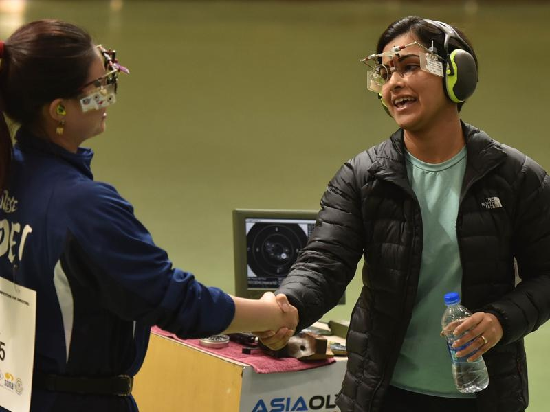 Sidhu is congratulated by a competitor from Taipei. (Ravi Choudhary/ HT Photo)