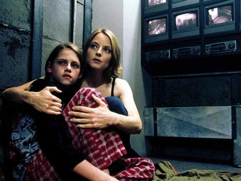 Panic Room (2002): A divorced woman and her diabetic daughter take refuge in their newly-purchased house's safe room, when three men break-in, searching for a missing fortune.