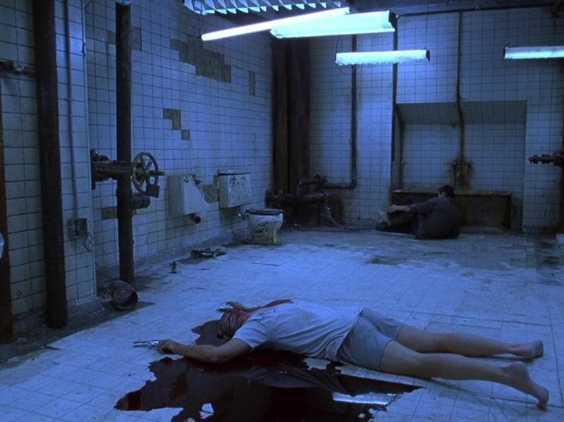 Saw (2004): Would you kill to live? When a madman tries to teach how much life is worth, two men find themselves in a room with no idea how they got there or why they're there.