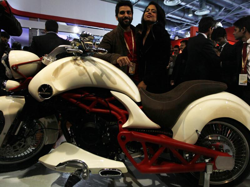 Sameera Reddy poses with a Vardenchi concept bike at the 12th Auto Expo 2014 in Greater Noida. (Raj K Raj/HT File Photo)