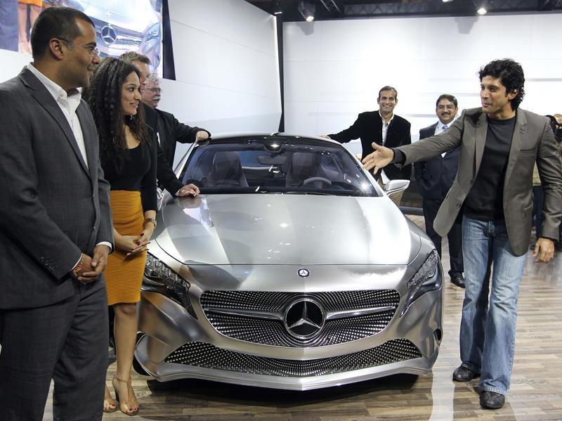 Actor Farhan Akhtar, Indian cricketer Irfan Khan and author Chetan Bhagat at the launch of Mercedes Concept-A during the 11th Auto Expo, 2012, at Pragati Maidan in New Delhi. (Raj K Raj/HT File Photo)