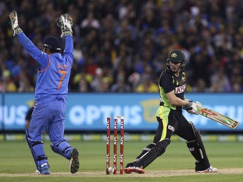Australia's James Faulkner is out stumped after a ricochet from the leg of India's Mahendra Singh Dhoni. (Reuters Photo)