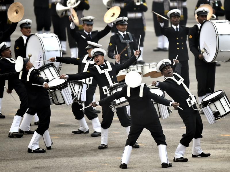 The boisterous drumming by the Naval band coupled with unique moves and a cheerful flourish, evoked spontaneous cheers from the audience including PM Narendra Modi, who was seen tapping his fingers on the arm of his chair. (Ajay Aggarwal/HT Photo)
