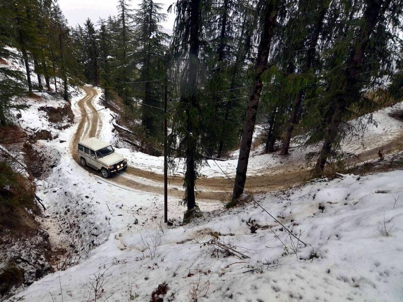 A vechicle moving slowly on a slippery road after snowfall at Kufri near Shimla on Friday.  (PTI )