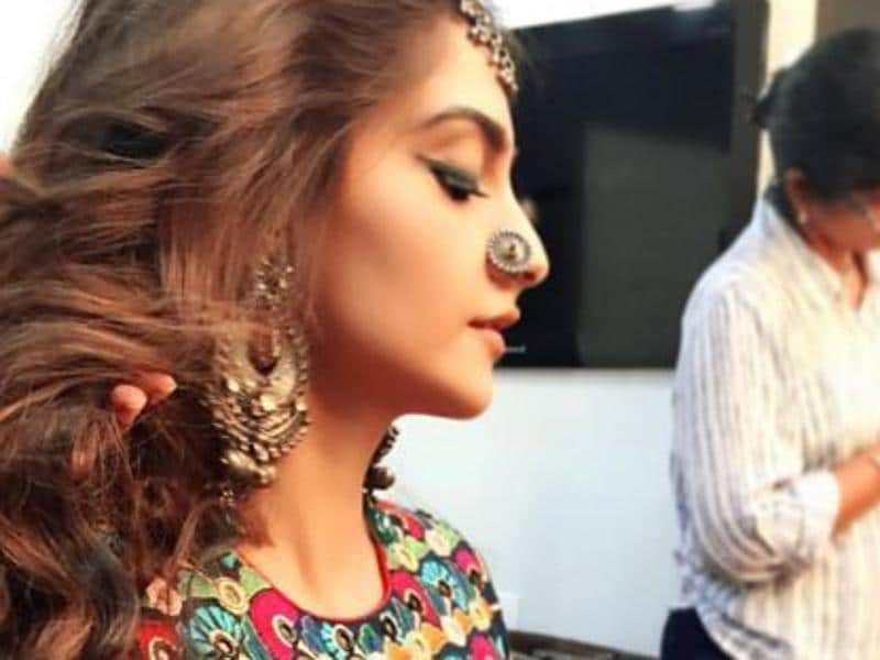 Rhea Kapoor shared Sonam's pic where she is getting decked up for her Coldplay video. (Instagram)
