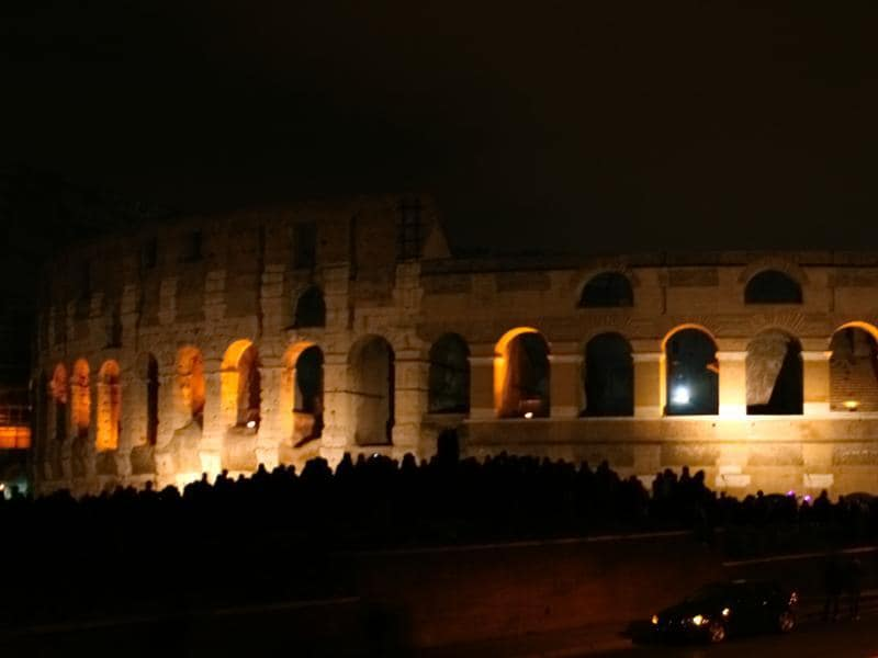 The Colosseum is lit up at night and the silhouette of  a crowd gathered at the laws is visible in front of the  ancient amphitheatre which used to hold markets, cultural programs and fierce competitions between gladiators and wild animals.   (Picture courtesy: Mad Art Photography)