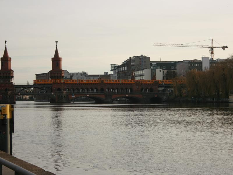 A view of the river Spree with the U-Bahn metro crossing over it. Berlin has an extensive public transportation networks, and its metro trains date back to the World War era. Some of the metro stations were even divided during the German divide after the fall of Nazism.     (Picture courtesy: Mad Art Photography)