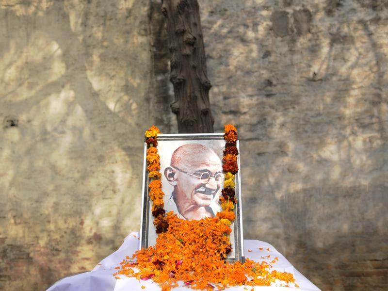 A portrait of Indian Independence icon Mahatma Gandhi, on his 67th death anniversary at Congress office, in Noida. (Burhan Kinu/ HT Photo)