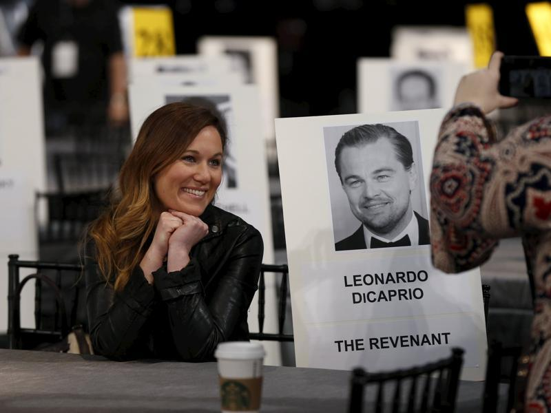 Zoe Ruderman, People magazine features director, poses next to the placard of actor Leonardo DiCaprio during preparations for the 22nd annual Screen Actors Guild Awards at the Shrine Auditorium in Los Angeles. (REUTERS)