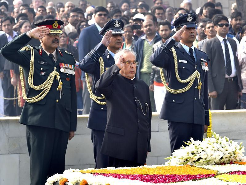 President Pranab Mukherjee salutes as he pays homage at Mahatma Gandhi's memorial, on Martyrs' Day marking the 68th anniversary of Gandhi's assassination in New Delhi. (Ajay Aggarwal/HT Photo)