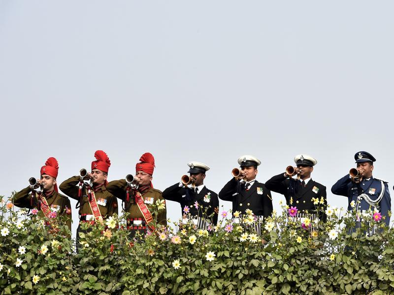 Soldiers line up to pay homage at Rajghat on Martyrs' Day marking the 68th anniversary of Gandhi's assassination in New Delhi. (Ajay Aggarwal/HT Photo)