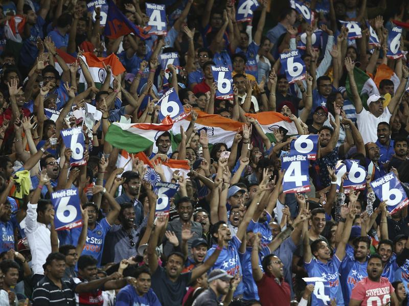 Indian fans cheer and celebrate as batsmen Rohit Sharma hits a six during their T20 match. (AP Photo)