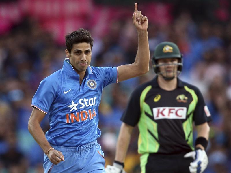 Indian bowler Ashish Nehra points up to the air as he celebrates taking the wicket of Australia's Usman Khawaja. (AP Photo)