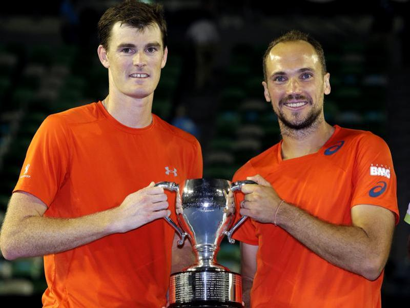 Jamie Murray and Bruno Soares hold their trophy after defeating Daniel Nestor of Canada and Radek Stepanek of the Czech Republic in the men's doubles final. (AP Photo)