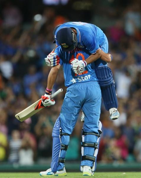 Suresh Raina on top celebrates with Yuvraj Singh of India after hitting a four last ball to win. (AFP Photo)