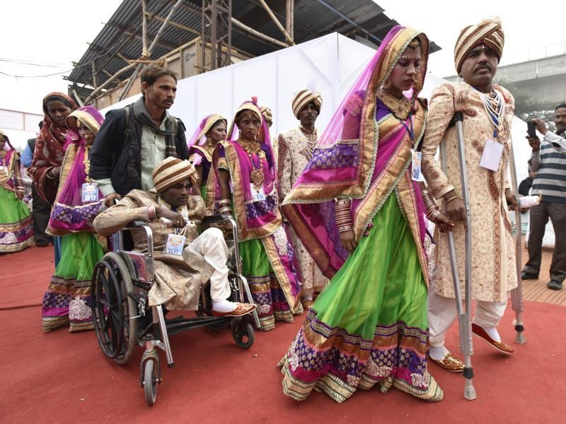 Differently-abled arriving at Janmasthmi Park where around 100 marriages took place on Sunday.  (Virendra Singh Gosain/HT)