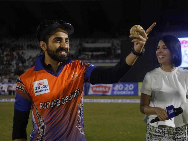Ayushmann Khurrana gestures towards the crowd during the match. (IANS)