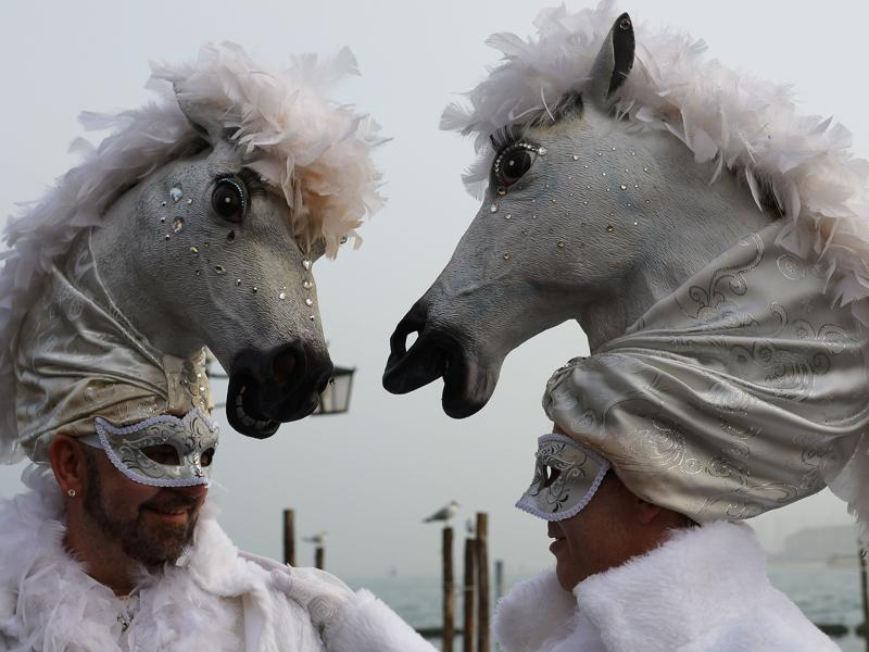 Costumed revellers pose in St Mark's square (Piazza San Marco) on January 31, 2016 in Venice. The 2016 edition of the Venice carnival is titled Creatum and runs until February 9. (AFP)
