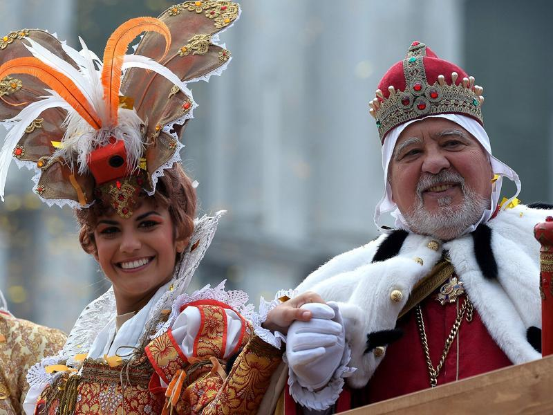 Performer Irene Rizzi poses with an actor dressed as a Doge (lord) after performing the Angel Flight or Flight of the Dove from the bell tower of Saint Mark's square.  (AFP)