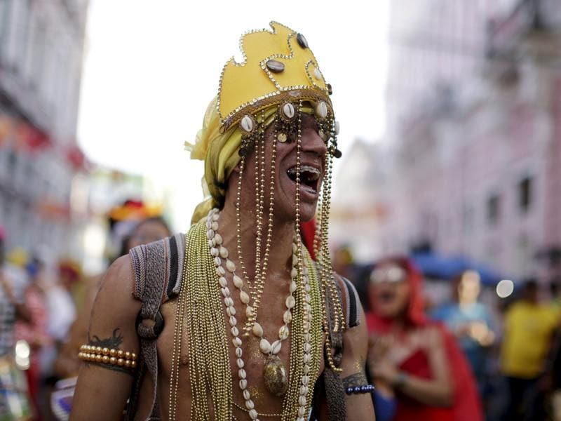 A reveller smiles during one of the many pre-carnival parties to take place in the neighbourhoods of Recife, Brazil, January 31, 2016. (REUTERS)
