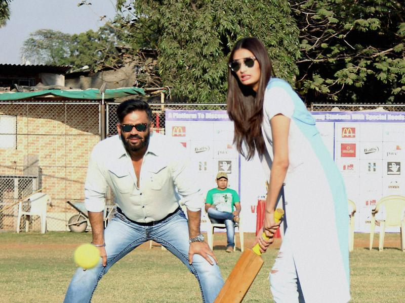 Meanwhile in Mumbai, Bollywood actor Suniel Shetty along with his daughter and actor Athiya Shetty during the Vishesh Cup cricket match of differently abled children. (PTI)