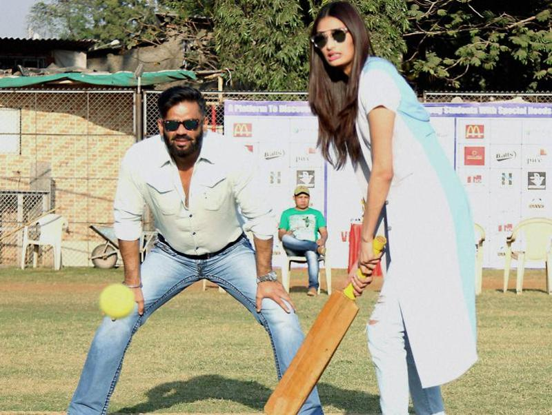 Suniel Shetty along with his daughter Athiya during the Vishesh Cup cricket match of differently abled children in Mumbai. (PTI)