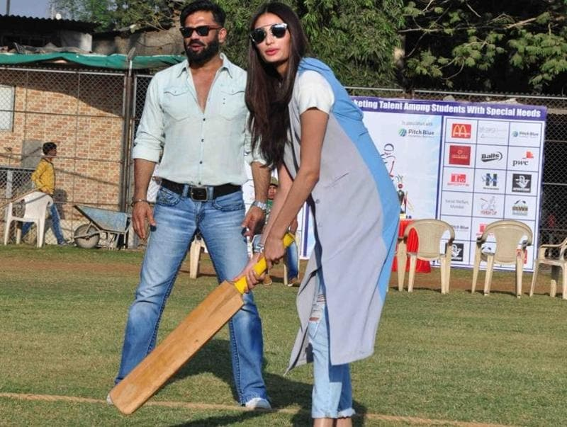 Meanwhile in Mumbai, Bollywood actor Suniel Shetty along with his daughter and actor Athiya Shetty during the Vishesh Cup cricket match of differently abled children. (IANS)