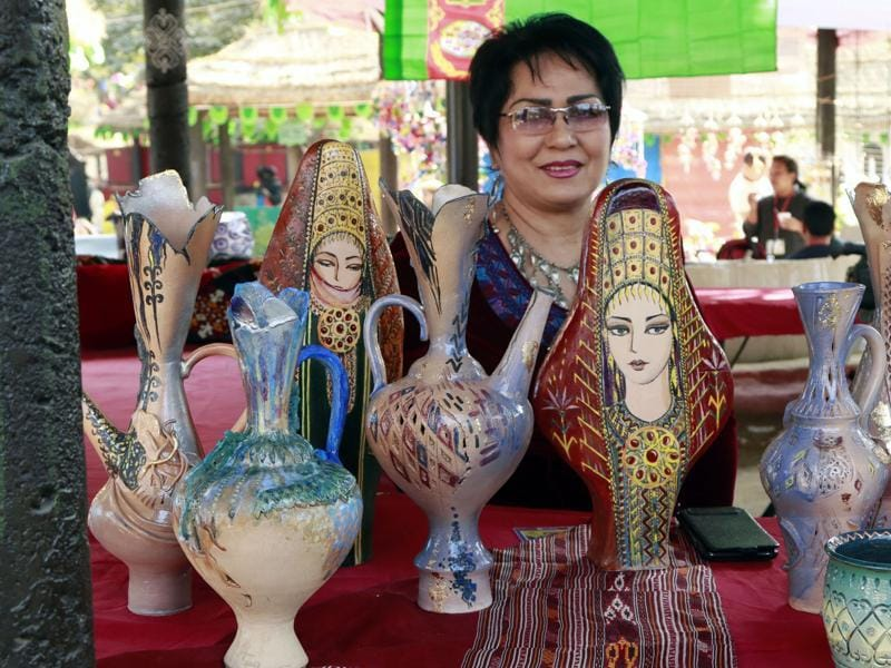 An artist from Turkmenistan showcasing her ceramic works at Surajkund Mela near Faridabad on Tuesday.  (HT photo)