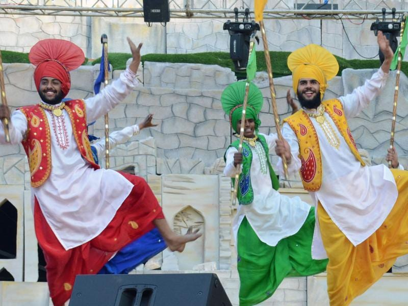 Surajkund Mela: Bhangra performers at the Chaupal  section of the international arts and crafts fair near Faridabad.  (HT photo)