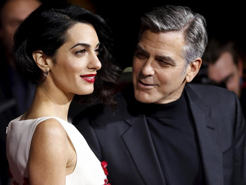 Needless to say George Clooney was handsome as ever but all eyes were on his barrister wife (even his own).   (REUTERS)