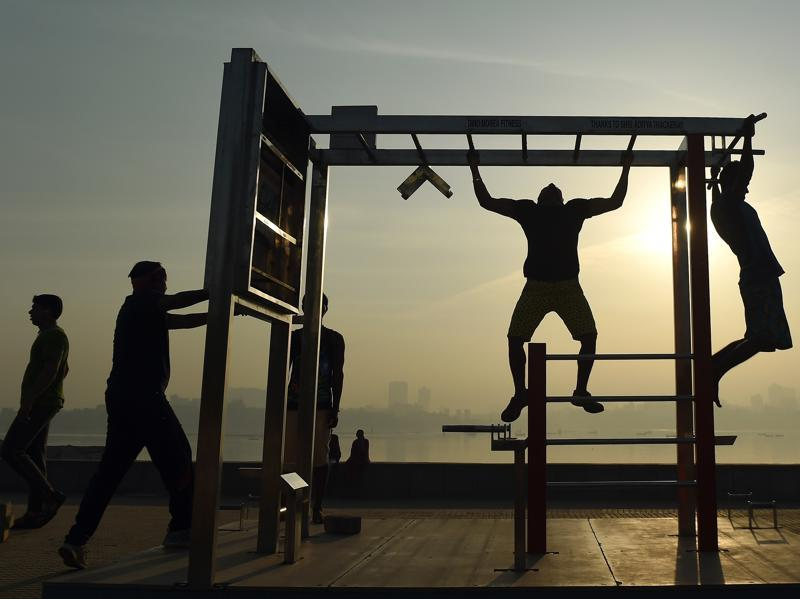 Youth exercising near the sea front during a hazy morning in Mumbai. (AFP)