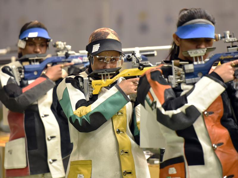Iranian shooter Khedmati Najmeh (center ) getting ready to take her shoot in 10 m air Rifle Shooting in Asian Olympic Qualifying Competition. (HT Photo)