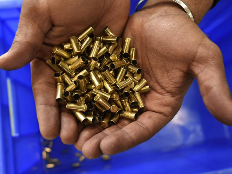 Used rounds from the 10m air pistol event, shown by an official at the Karni Singh range. (HT Photo)