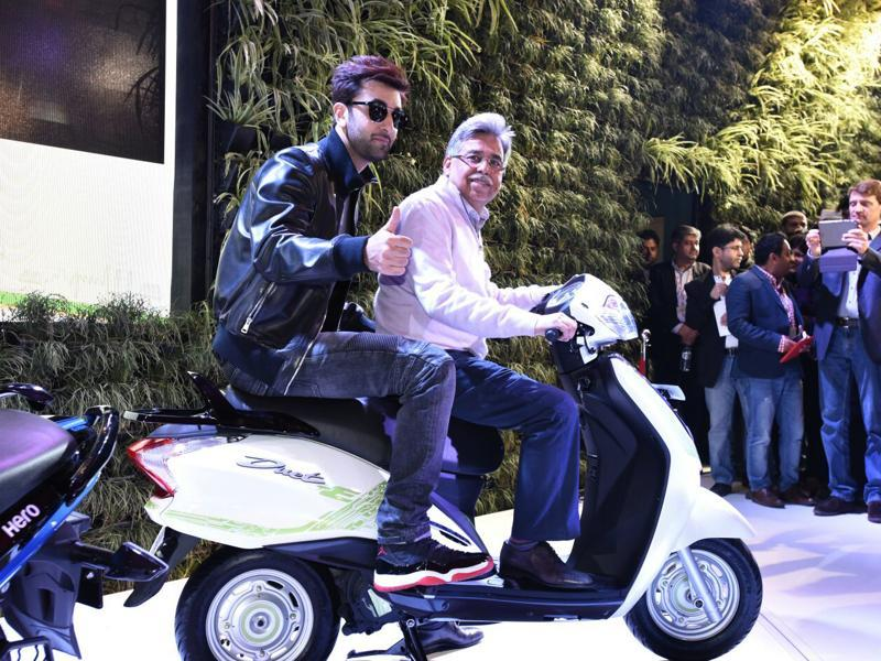 Hero MotoCorp also launched an electric scooter concept Duet-E. The scooter has been based on the current production series scooter, the Duet, to make it cost effective. Actor Ranbir Kapoor added to the glitz of the event.   (Mohd Zakir/HT Photo)