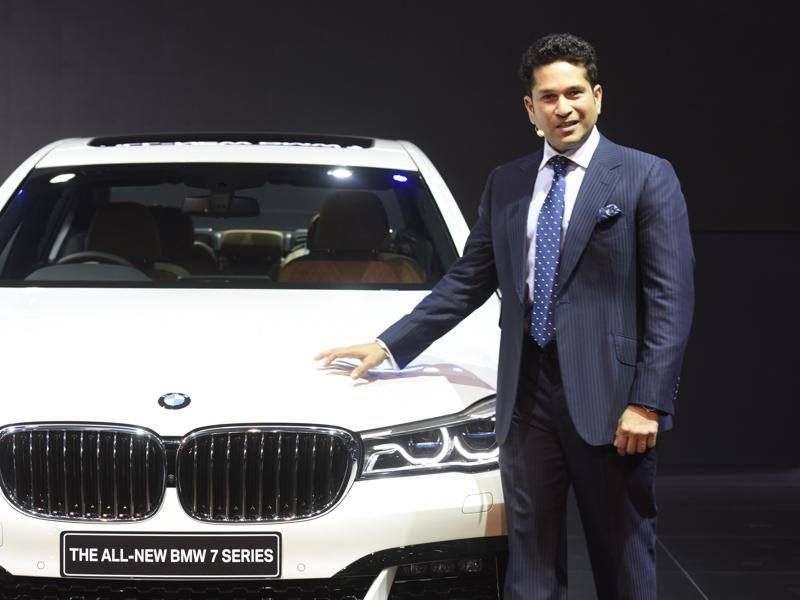 Sachin Tendulkar stands next to BMW 7-Series on its launch at Auto Expo 2016.   (Mohd Zakir/HT)