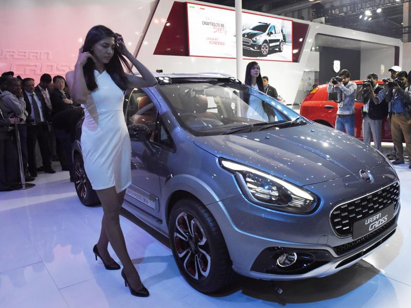 A model promotes Fiat's Urban Cross car at the exposition.  (Mohd Zakir/ HT Photo)