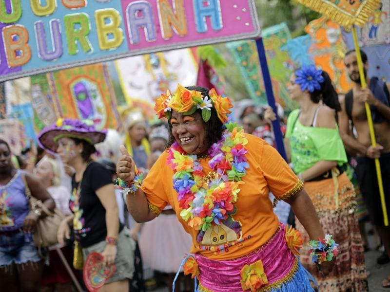A patient from the Nise de Silveira mental health institute dances in costume during the institute's carnival parade, called in Portuguese: