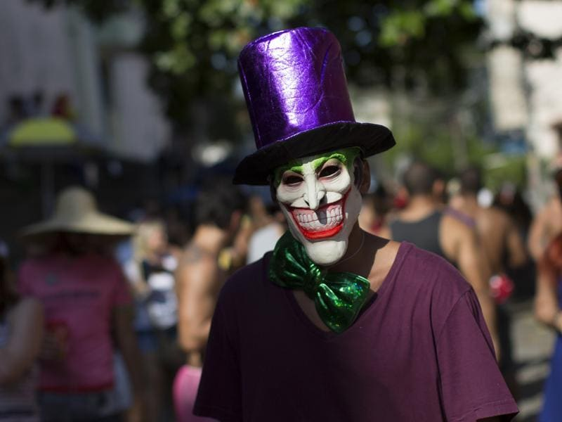 A reveller wearing a mask depicting the 'The Joker' comic character, attends the 'Carmelitas' block party during Carnival celebrations in Rio de Janeiro, Brazil. (AP)