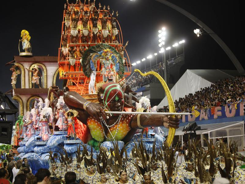 Dancers from the Unidos da Vila Maria samba school perform on a float during a carnival parade in Sao Paulo, Brazil. (AP)