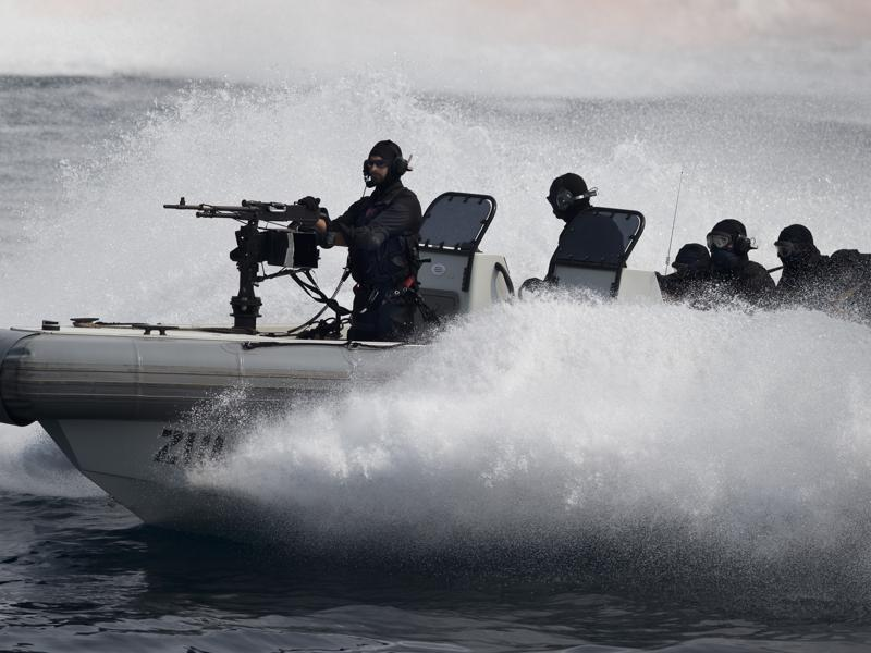 Indian naval commandos show their prowess during the International Fleet Review in Vishakapatnam. (AP Photo)