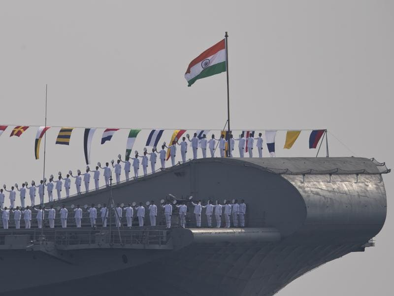 Indian sailors aboard the India's second aircraft carrier Viraat, line up to salute the Indian President Pranab Mukherjee, during the International Fleet Review in Vishakapatnam. (AP Photo)