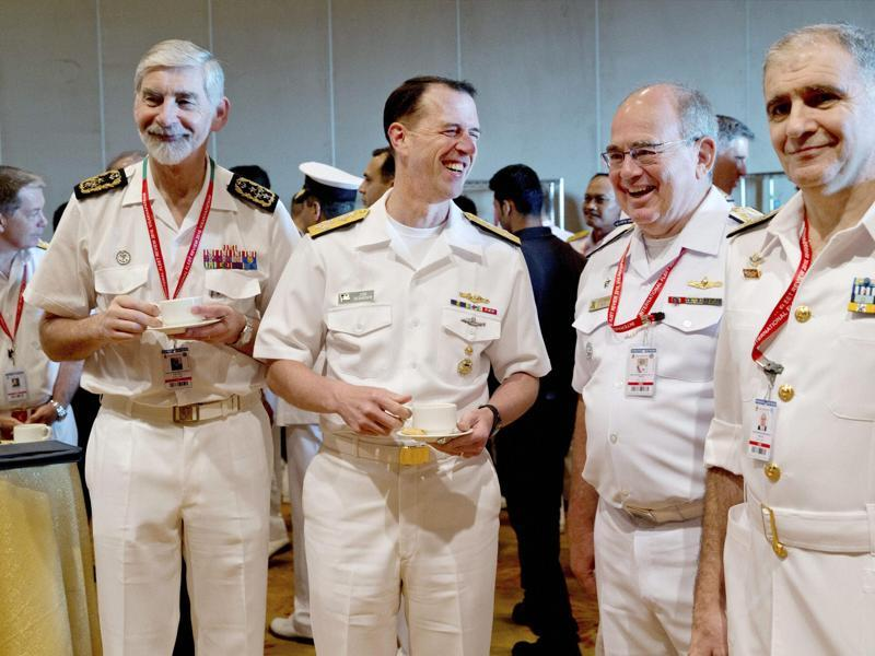 US chief of naval operations John Richardson, second left, shares a laugh with Portuguese chief of navy Luís Macieira Fragoso, left, Brazilian Navy commander Eduardo Bacellar Leal Ferreira, second right, and an unidentified naval officer during the International Fleet Review in Vishakapatnam. (PTI Photo)