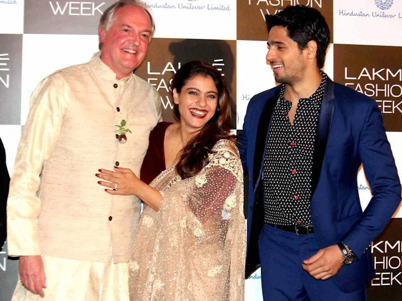 Kajol and Sidharth Malhotra with Global CEO, Hindustan Unilever Limited, Paul Polman at the curtain raiser event of Lakme Fashion Week in Mumbai. (PTI)