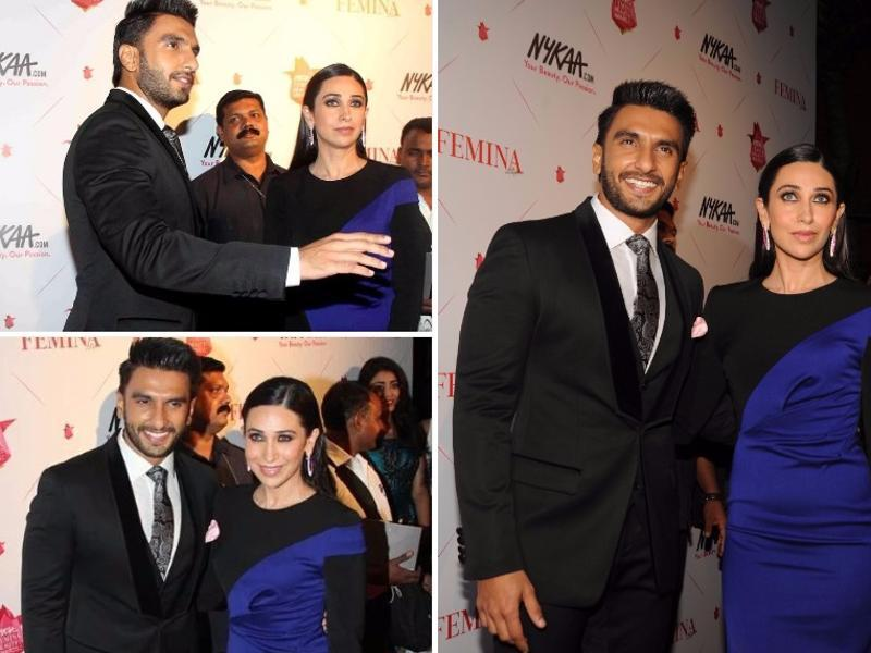 Bollywood actor Karisma Kapoor makes a bold statement with her blue-and-black number as she posed with Ranveer  at Femina Beauty Awards in Mumbai. (AFP)